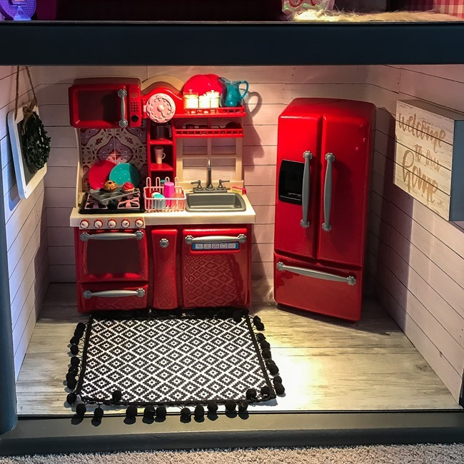 Old entertainment center turned American Girl dollhouse-19