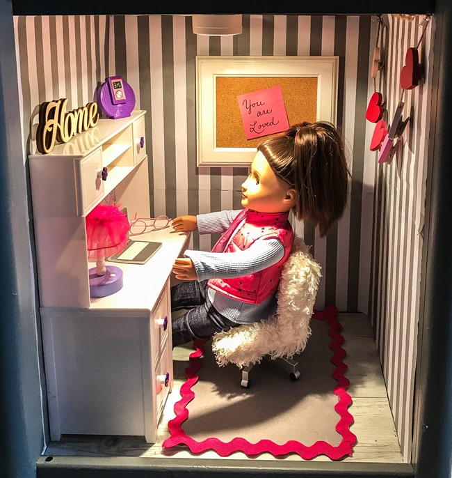 Old entertainment center turned American Girl dollhouse-20