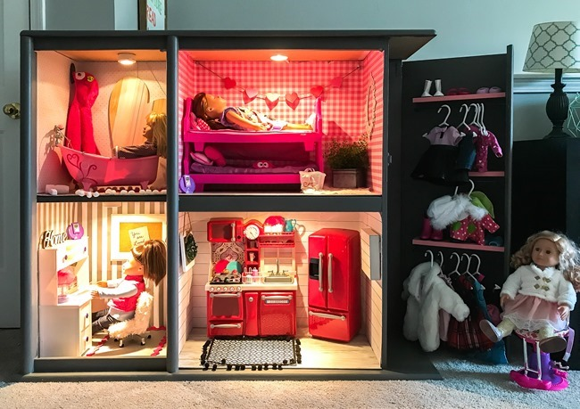 Old entertainment center turned American Girl dollhouse-22