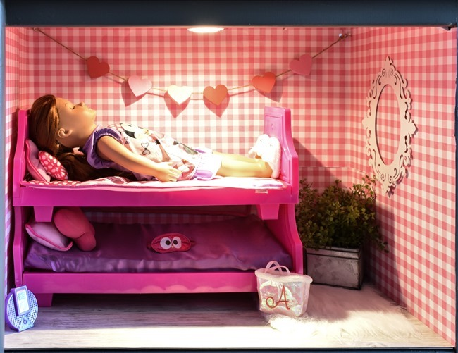 Old entertainment center turned American Girl dollhouse-9